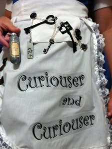 "Apron and ""drink me"" bottle"